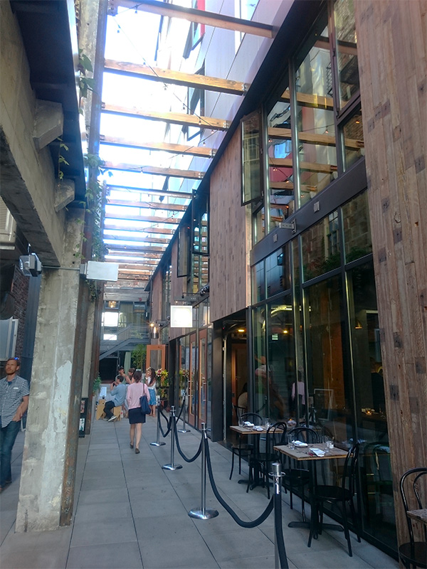 The Chophouse Row development in Capitol Hill, Seattle provides a new alley connection with cafes and restaurants activating the space at different times of day. Photo by Sarah Oberklaid.