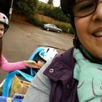Shirley Savel biking with the kids.