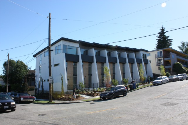 A rowhouse of six units is a recent addition at 46th and Whitman Avenue.