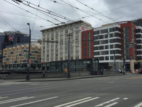New apartment buildings (Hirabayashi Place Apartments on the left, Icon Apartments on the right) flank the Addison on Fourth.