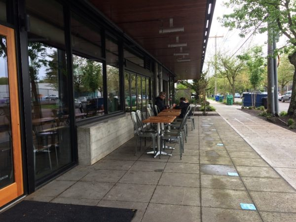 Feed Co. Burgers with a fence-free sidewalk café in the Central District. (City of Seattle)