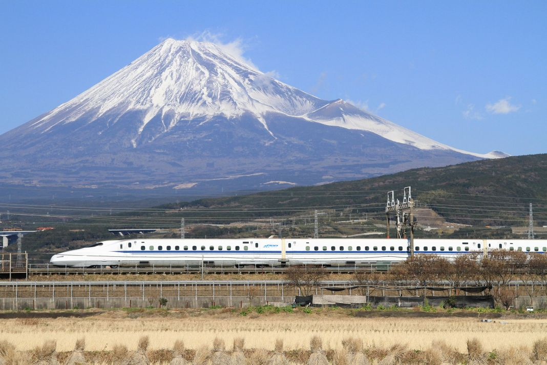 The Tōkaidō Shinkansen high-speed line in Japan, with Mount Fuji in the background. The Tokaido Shinkansen was the world's first high-speed rail line. (Wikipedia / tansaisuketti)