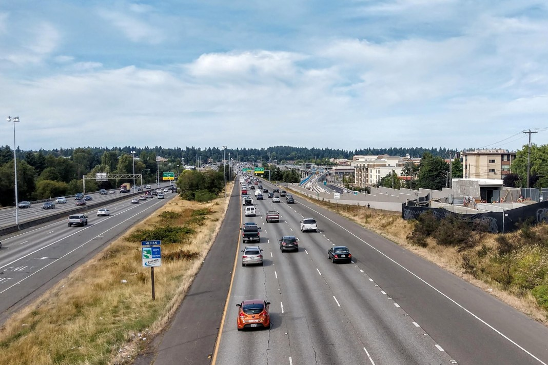 I-5 through Northgate section of Seattle. Northgate Station rises on the right.(Photo by Doug Trumm)