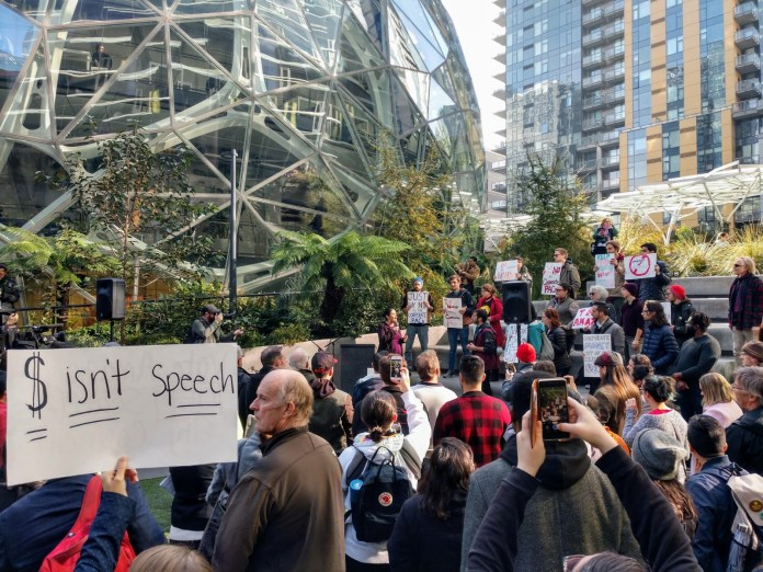 About a 100 people rallied against Amazon for trying to buy the Seattle City Council elections. (Photo by Doug Trumm)