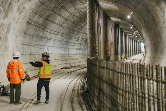 Workers in the tunnel under downtown Bellevue, which stretches from East Main Station to Bellevue Downtown Station. (Sound Transit)