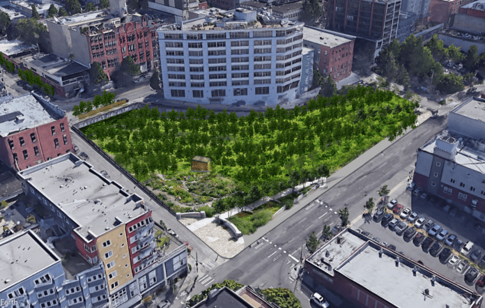 A rendering shows a triangle shaped green park with trees surrounded by buildings and streets.
