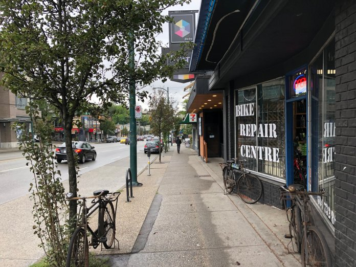 Mount Pleasant features a six-lane BC Highway 7 bisecting the neighborhood with adequate sidewalks, storefronts and biking facilities. Pedestrians benefit from adequate sidewalks and a tree-lined planting buffer. (Image by the author)