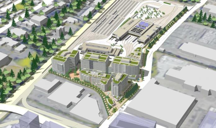 Rendering of the TOD site and OMF East shows six mid-rise buildings plus the light rail facilities. (Sound Transit)