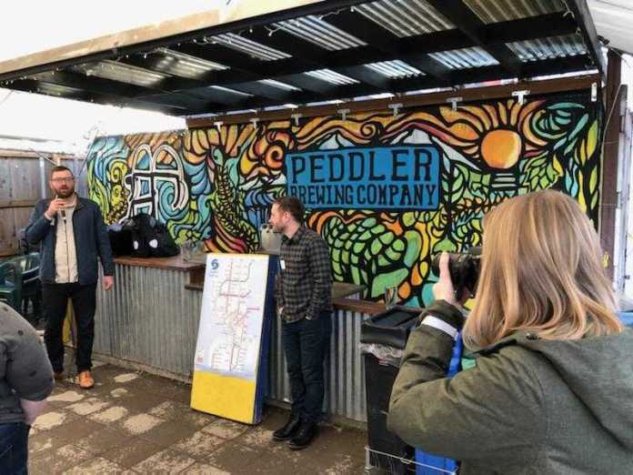 Owen and Doug address fundraiser attendees at Peddler Brewing. (Photo by Rian Watt)
