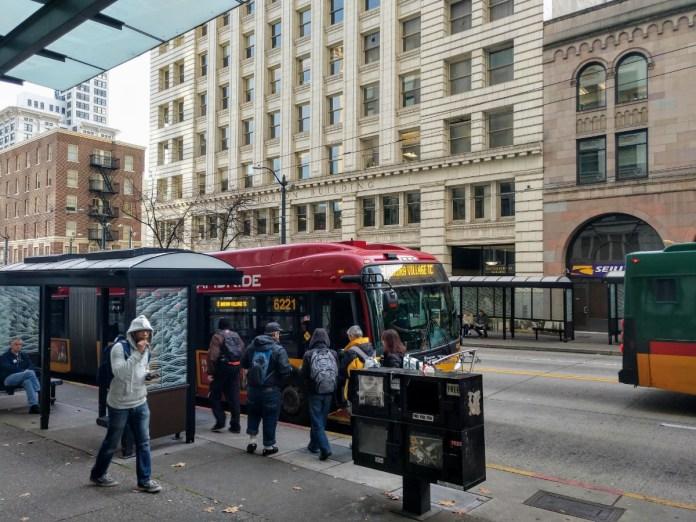 Passengers board the RapidRide E on Third Avenue. (Photo by Doug Trumm)