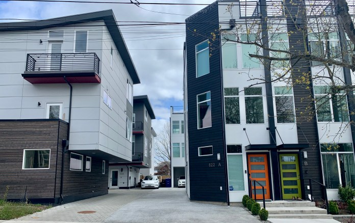 Two recently newer townhouse developments share a central driveway. (Photo by author)