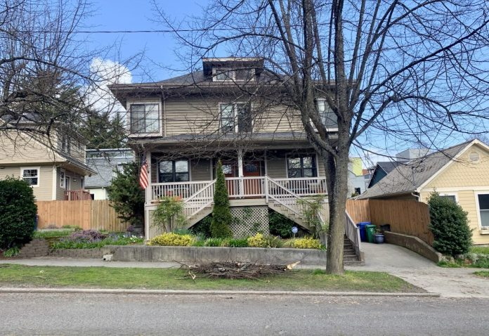 Look carefully, what appears to be a single family residence here is actually a duplex. (Photo by author)