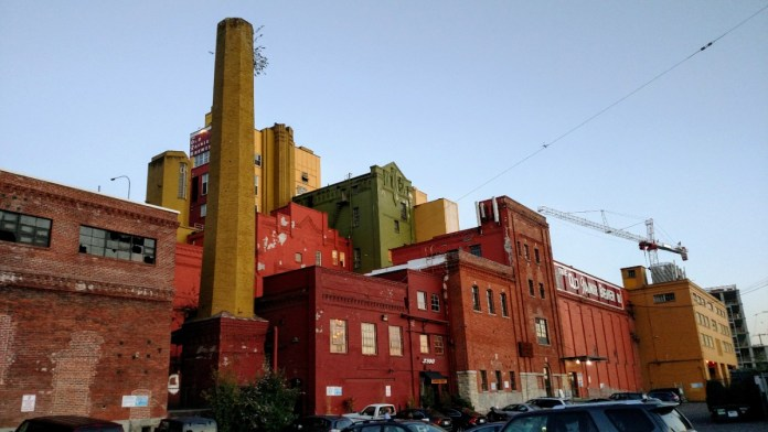 Seattle's old Rainier Brewery no longer brews beer, but it is does house some of Seattle's creative community as live-work art lofts. (Photo by Doug Trumm)