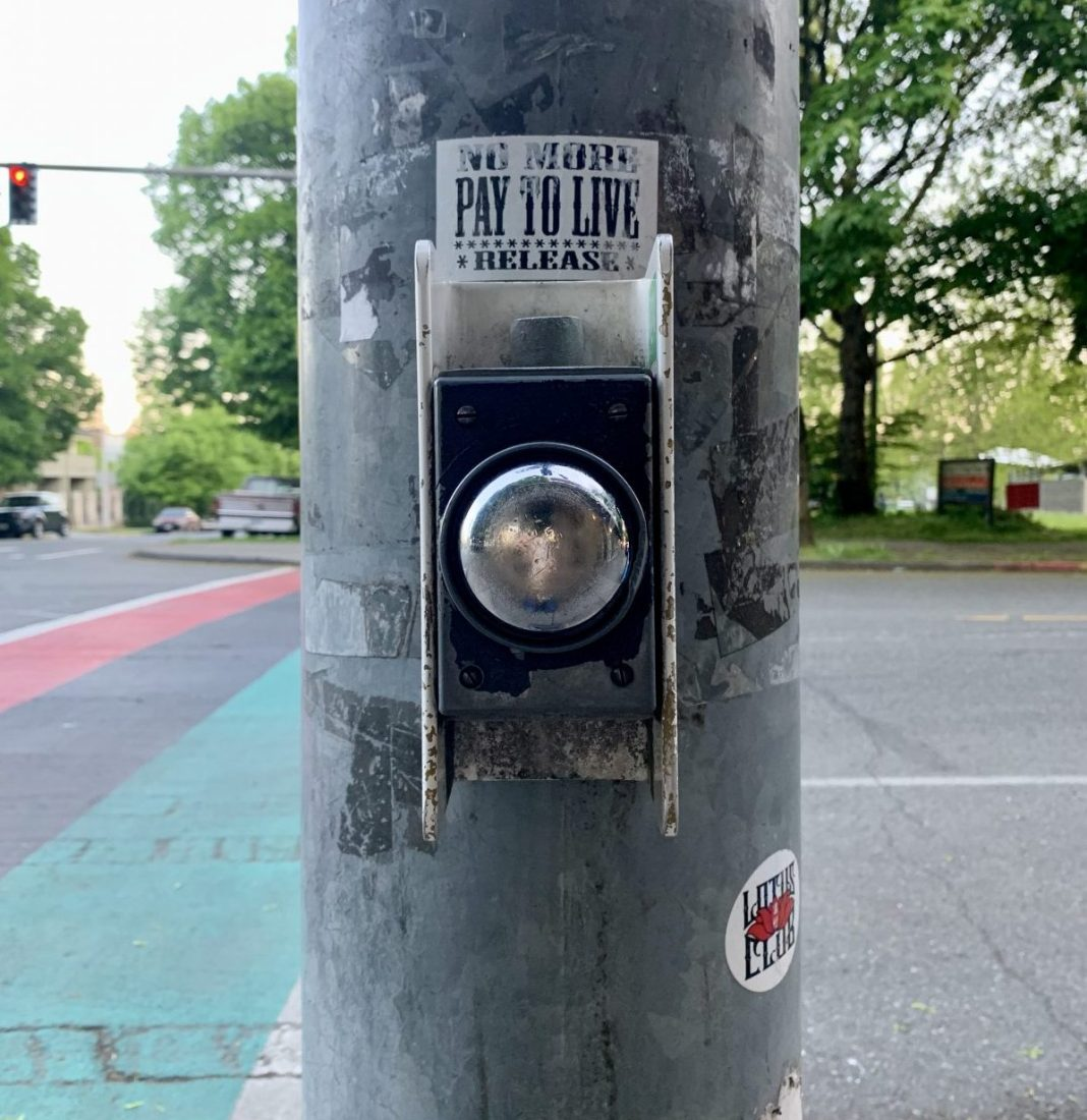 An example of a push button that needs to be activated to trigger the walk signal (aka. beg button) in the Central District. (Photo by author)