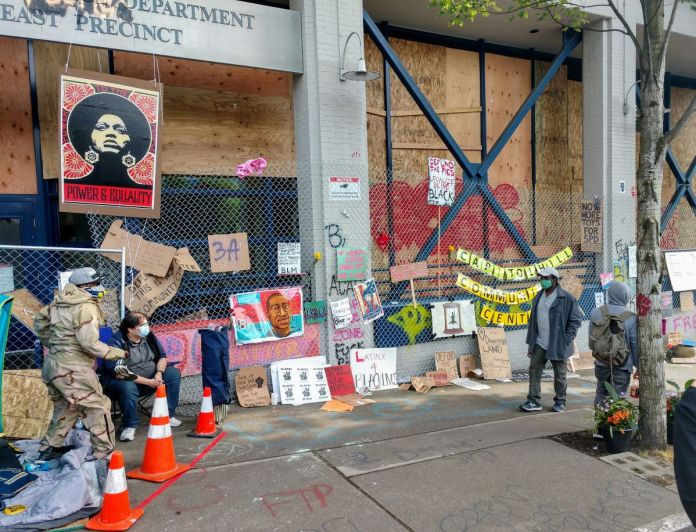 The memorials along the East Precinct police station--now christened the Capitol Hill Community Center--keep growing. (Photo by Doug Trumm)