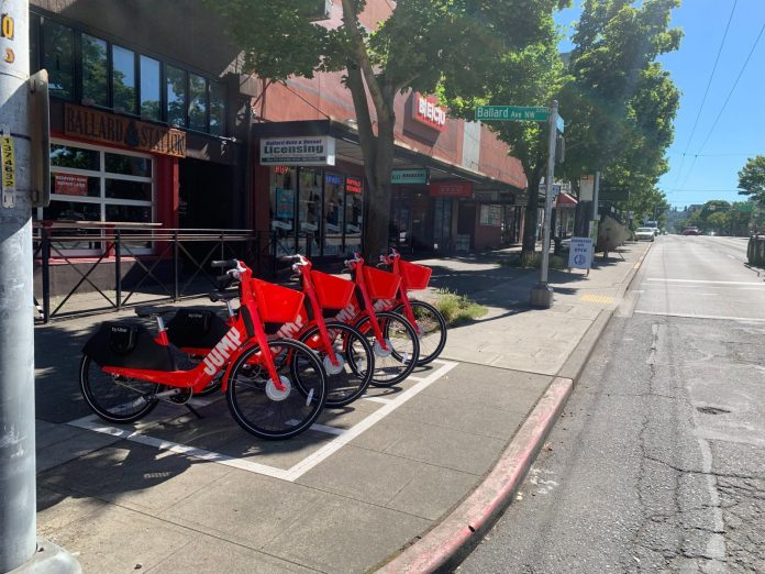 Lime-owned red Jump bikes in Ballard drop-off zone. (Courtesy of Lime)