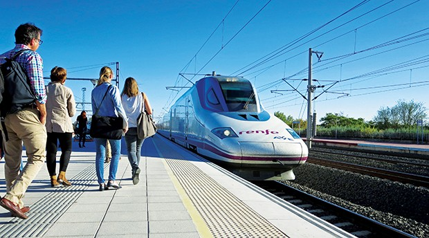 An high-speed train pulls into a station and passengers approach. (Photo courtesy Midwest High Speed Rail Association)