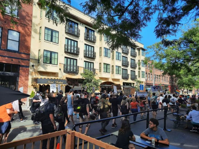 Hundreds of Black Lives Matter protesters march on Ballard Avenue.