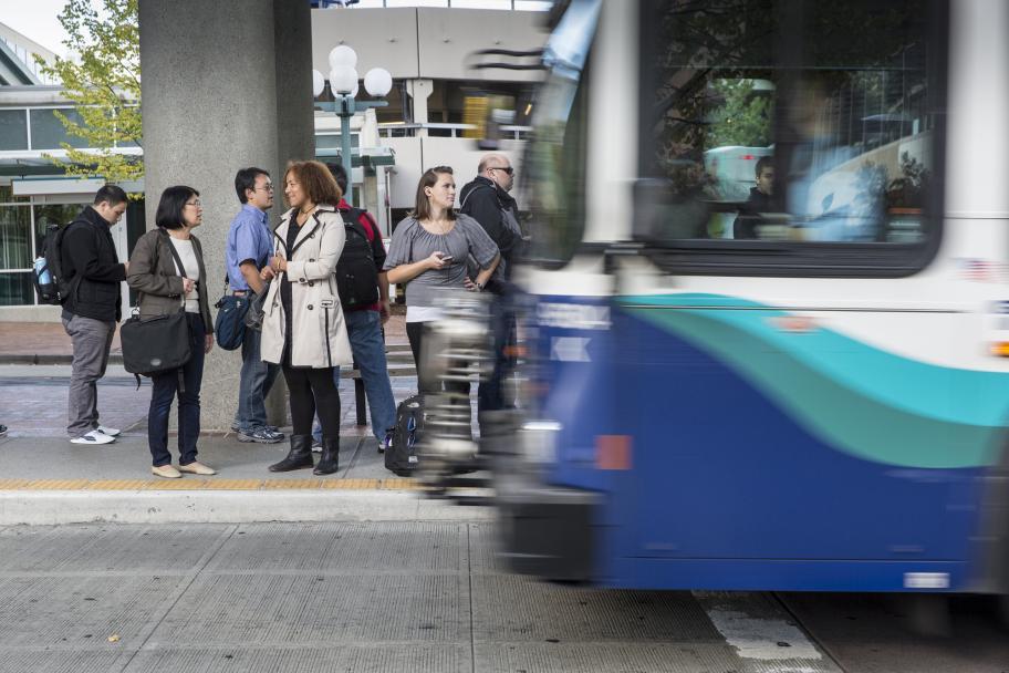 Seven passengers wait to board a Sound Transit bus. (Photo courtesy of Sound Transit)