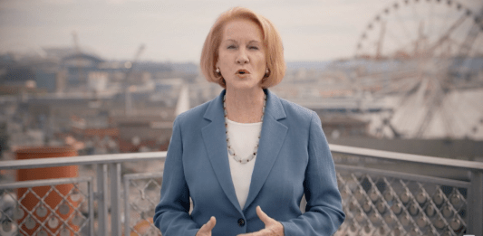 Mayor Durkan with Ferris wheel and Seattle waterfront in background