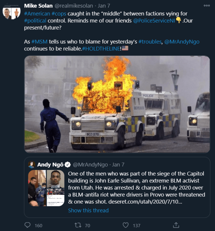 """Solan quote tweets a Andy Ngô conspiracy theory about Black Lives Matter being responsible for the Capitol violence and says """"#American #cops caught in the """"middle"""" between factions vying for #political control. Reminds me of our friends  @PoliceServiceNI Down pointing backhand index. Our present/future?  As #MSM""""tells us who to blame for yesterday's #troubles, @MrAndyNgo  continues to be reliable. #HOLDTHELINE! Flag of United States"""