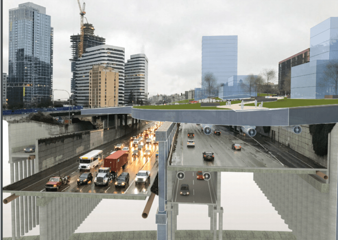 A park-like is shown over the freeway trench in this cross section.