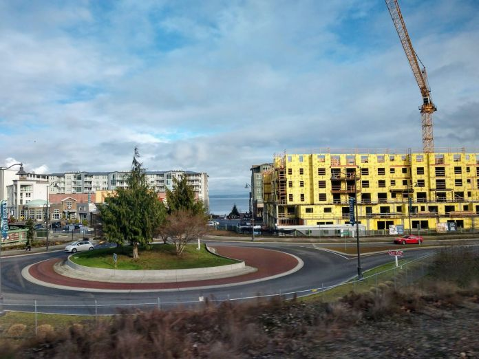 A large construction project near a roundabout in Tacoma.
