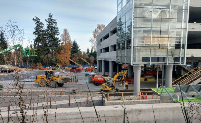 Construction workers and heavy equipment at the light rail station near Microsoft's Redmond headquarters.