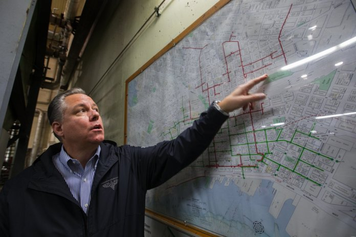 David Easton of Enwave Seattle, formerly Seattle Steam, points to a chart of steam lines running underneath Seattle. (Credit: Ellen M. Banner / The Seattle Times)