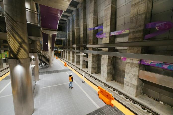 A construction stands on the underground station platform at Roosevelt Station.