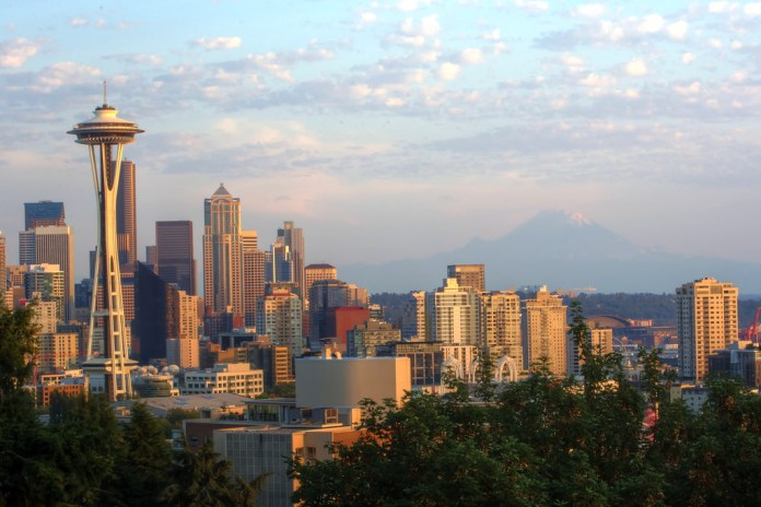 A photograph showing the skyline Downtown Seattle's tall buildings at sunset as viewed from Kerry Park in Queen Anne.