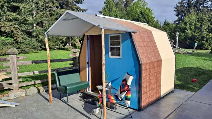A view of a tiny house creation with a front porch from LiteHouse Shelters.