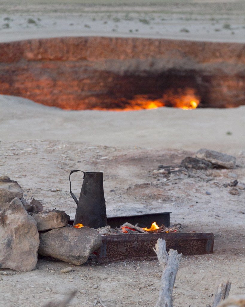 A campfire beside the Gates of Hell (DarkyDoors/Shutterstock)