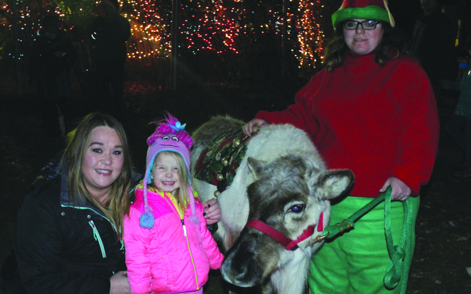 Steger Parade-Kayleigh Vandenburg with her mom Tracy visiting with a reindeer at the Christmas in the Boulevard