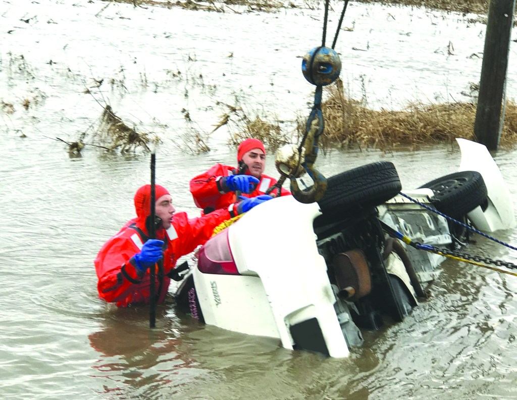 Peotone firefighters were called out Tuesday at 8:30 a.m. for a reported car upside down in the water at Rt. 45 and Wilmington Rd. Crews found the car just south of Barr Road in the field with just the tires showing. Rescuers entered the water in cold water suits and used chains, rope, and tools to tip Toyota Yaris slightly so they could search for victims, where they found a deceased female.