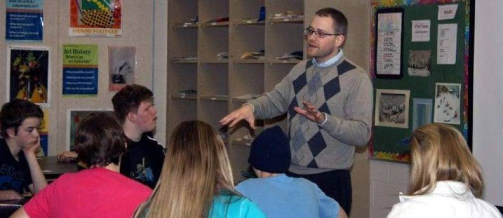 SPEAKER ... Chris Kannel speaks to students in an art class at Montpelier School.