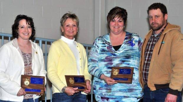 2013 HONORARY FFA MEMBERS … Each year, as provided by its constitution, Edon FFA Chapter members honor individuals who have contributed their time and talents in assisting the chapter with planned activities and projects.  Receiving plaques for their dedication over the years are, from left, Kris Dulle, Louise Dick and Tina and Steve Parrish.