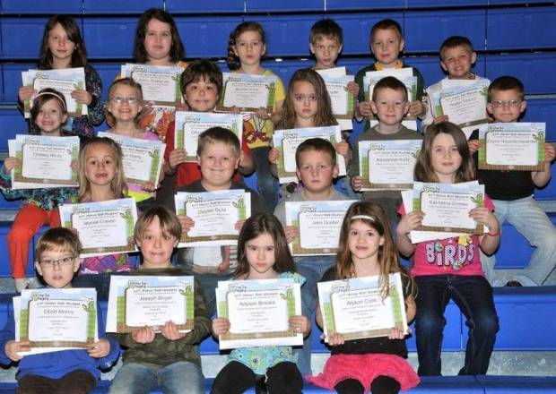 FIRST GRADE BUG AWARDS … First Graders honored for bringing up their grades during the 2012-2013 Third Nine Week Grading Period in Mrs. Hall's and Mrs. Thiel's classes were:  Front row, from left, Elliott Mohre, Joseph Boyer, Adyson Brooks and Alyson Cook.  Second row, from left, Jaycea Craven, Clayton Dulle, John Goebel and Katrionna Grimes.  Third row, from left, Chelsey Haury, Joslyn Horne, Christopher Joice, McKenzie Main, Alexzander Kurtz and Zayne Neuenschwander.  Top row, from left, Anastasha Owens, Ashlin Rodriguez, Baylee Scher, Rowan Snyder, Aiden Terrill and Peyton Trausch.  Not pictured ~ Kole Olds.