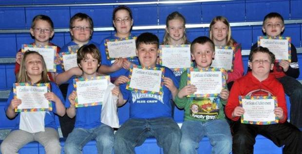 """SECOND AND THIRD GRADE AWESOME ACHIEVERS … Edon Northwest Elementary Second and Third Grade students honored as """"Awesome Achievers"""" for receiving all 4s or all 4s and 5s during the 2012-2013 Third Nine Week Grading Period were:  Front row, from left, second graders Hannah Kennedy, Jack Morris and third graders Jayden Craven, Terran Dunbar and Jack Fifer.  Back row, from left, third graders Drew Gallehue, Cassius Hulbert, Ashley Kaylor, Carlie Kiess, Olivia Mitchell and Ethan Steinke."""