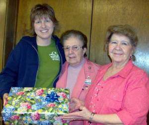 GUEST SPEAKER ... Sandy Gordon, left, of Montpelier Parks & Recreation was guest speaker on the summer lunch program at the park at CHWC-Montpelier Hospital Auxiliary meeting Monday, April 8th at St. Paul's United Methodist Church Robison Room. She is pictured receiving an appreciation gift from auxiliary members Pauline Brillhart, past president, center, and Marty Brace, historian, right. Mrs. Gordon was the guest of Armeda Sawmiller, program committee.