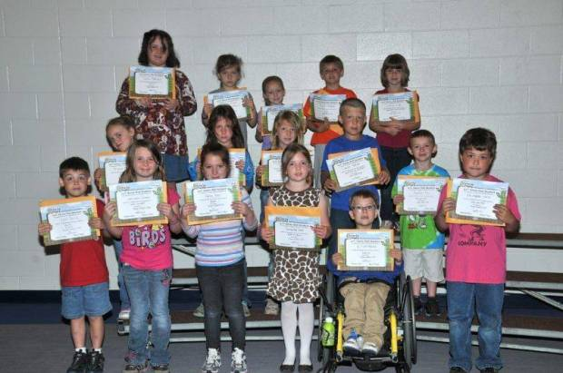 FIRST GRADE BUG AWARDS … First Graders honored for bringing up their grades during the 2012-2013 Fourth Nine Week Grading Period in Mrs. Hall's and Mrs. Thiel's classes were:  Front row, from left, Caleb Derico, Katrionna Grimes, Haley Guy, Samantha Hake, Elliott Mohre and Christopher Joice.  Middle row, from left, McKenzie Main, Anastasha Owens, Taylor Pack, Lance Reitzel and Ashton Rice.  Back row, from left, Ashlin Rodriguez, Baylee Scher, Kendall Siebenaler, Peyton Trausch and Lainee Wells.