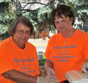 ANNUAL GATHERING … Sue Lloyd and Riki Timbrook, from left, prepare one of many lunches served by Edon State Bank staff during their 16th Annual Customer Appreciation Day.