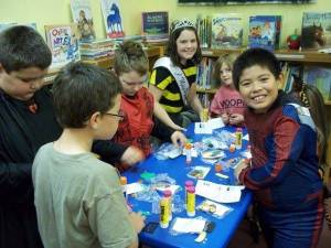 CRAFTY BUNCH ... The children also made crafts during the party. From left to right are: Zach Secord, Evan Livengood, Makana Swindell, Emily Eustace, Paige Oxender, Sophie Eustace (partially hidden), and Mario Marmolejo.