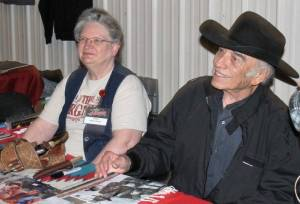 James Drury, also known as the Virginian, sits next to his assistant Karen Lindsey and signs autographs and greets event goers.