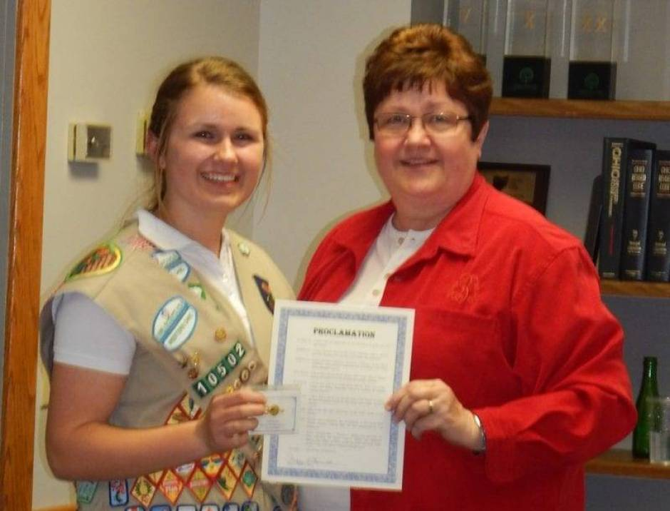 Peg Bernath, West Unity Village Mayor, acknowledged the efforts that led Colleen Bell to become one of only five percent of Girl Scouts to earn the Gold Award during the April 14 meeting of the West Unity Village Council.  Bernath proclaimed the date to be Girl Scout Colleen Bell's day within the village as well as gave Bell a symbolic key to the village.