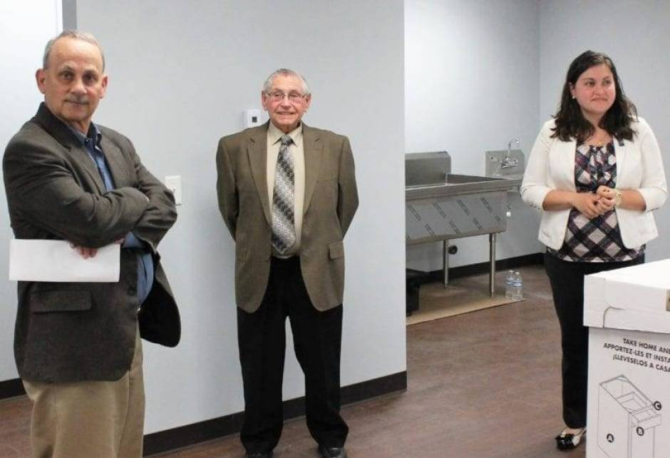 Commissioners Bill Rufenacht and Paul Barnaby tour the new community center with Rosanna Hoelzle.