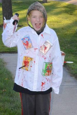 CAP'N CRUNCH'S WORST NIGHTMARE … Eight year old 'Cereal Killer' Hayden Veres of Bryan shows off his Halloween costume prior to the judging event.