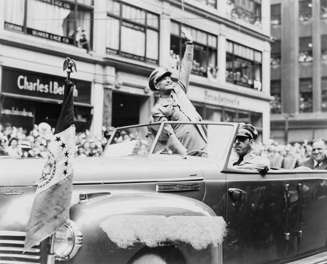 Dwight Eisenhower waves to crowd in 1945