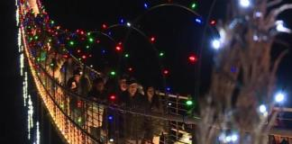 In Gatlinburg, TN, the longest pedestrian suspension bridge in the US has been transformed into a 680 foot tunnel of Christmas lights overlooking the Smoky Mountains.