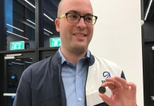 SpaceIL co-founder Yonatan Winetraub, National Institutes of Health award winner, displaying a copy of the coin-size nano Bible in the time capsule aboard Beresheet. (Abigail Klein Leichman)